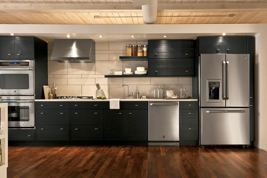 Dark brushed metal finish appliances are elegant and easy to maintain.