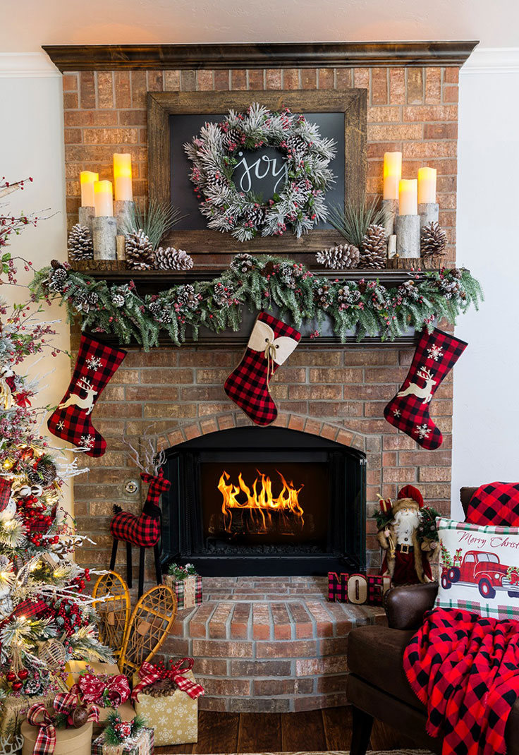 This fireplace is beautifully decorated with frosted and non-frosted pinecones, spruce, and a little bit of winterberry stems