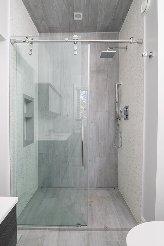 Sleek walk in shower with sliding glass door - Bathroom renovation