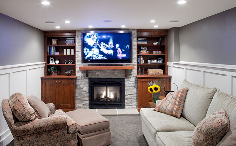 Fireplace with built in shelving units - Basement finishing